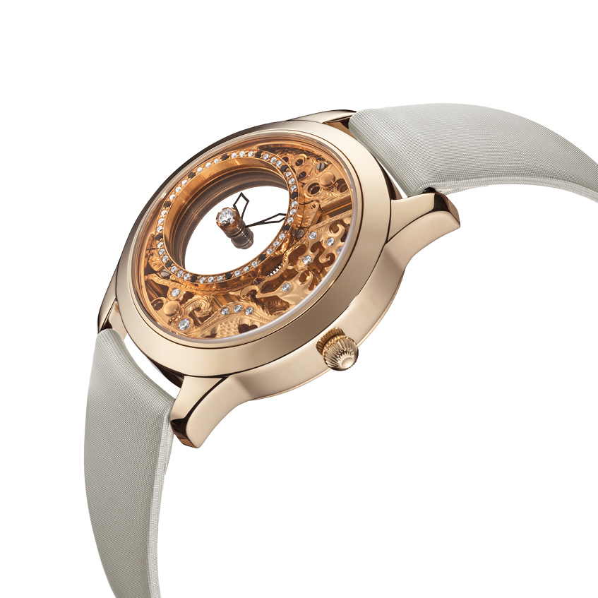 женские часы из желтого золота Ника